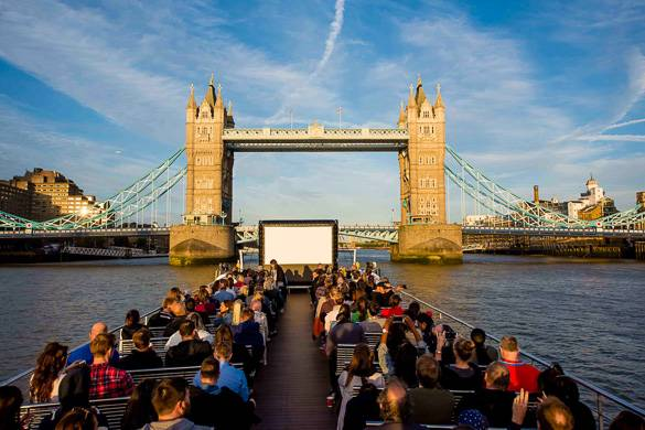 Image of a boat with an outdoor movie screen on top