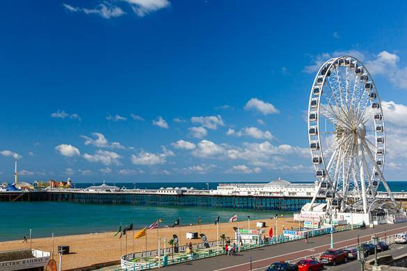 Image of sea and boardwalk with Ferris wheel in Brighton, England