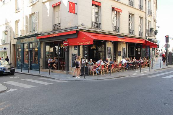 Image of people enjoying the crisp fall weather at a French cafe