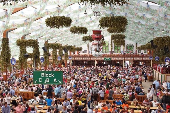 Image of crowds in a large indoor beer garden for Oktoberfest