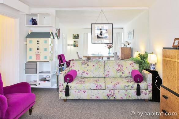 Image of living room of LN-1915 in Paddington with floral couch and magenta accents