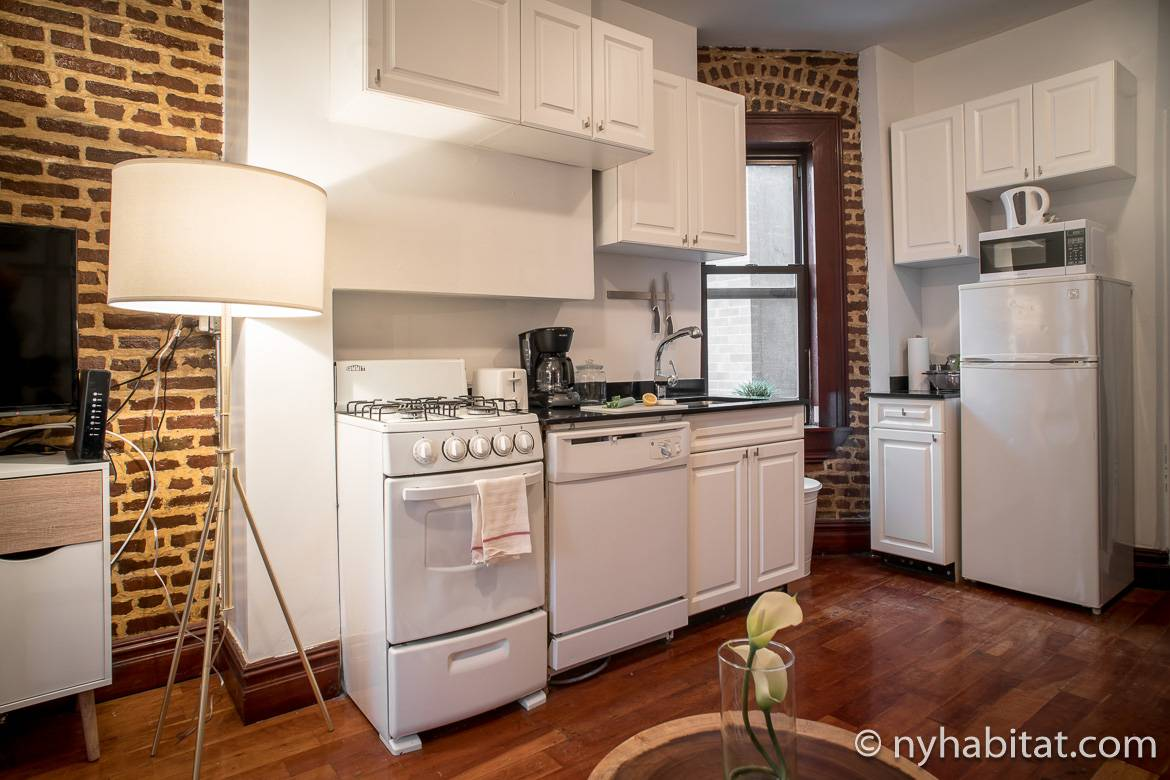 Image of kitchen of the NY-17254 apartment with exposed brick walls