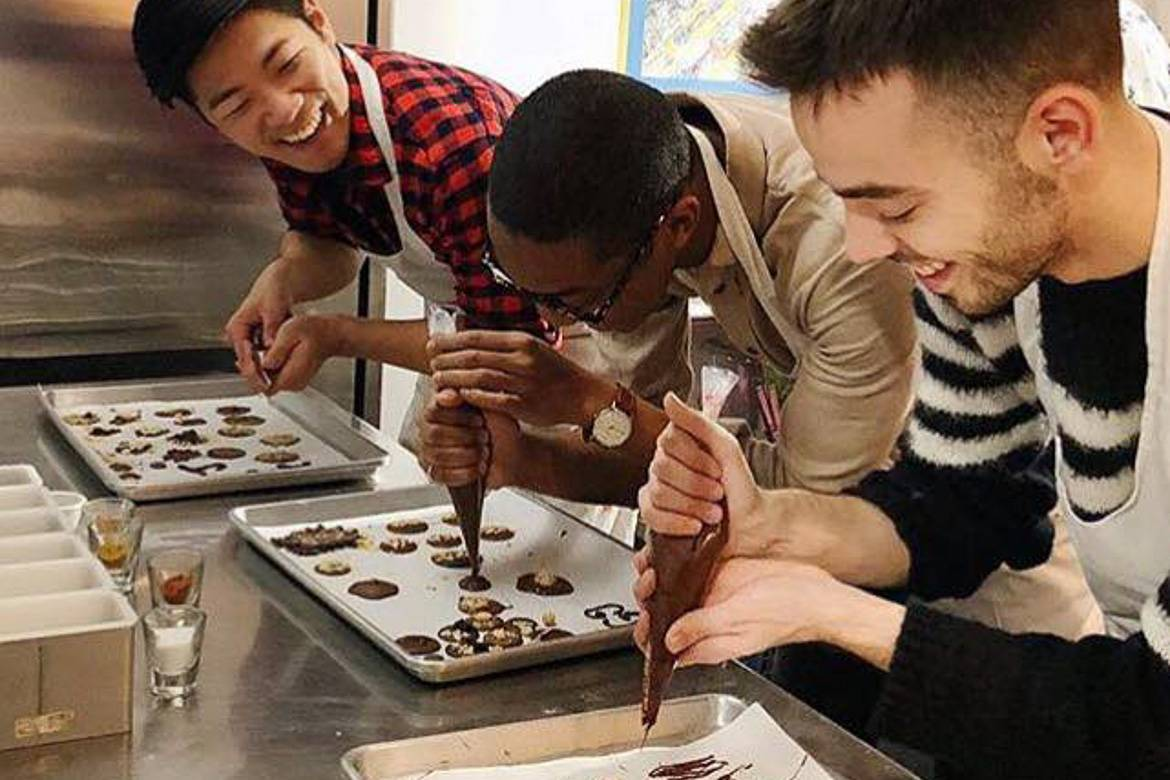 Image of people learning how to make chocolates in a class