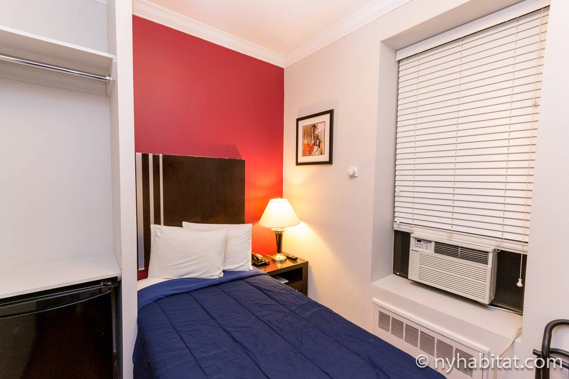 Image of a room with single bed in a dormitory-style building on the Upper West Side (NY15065)