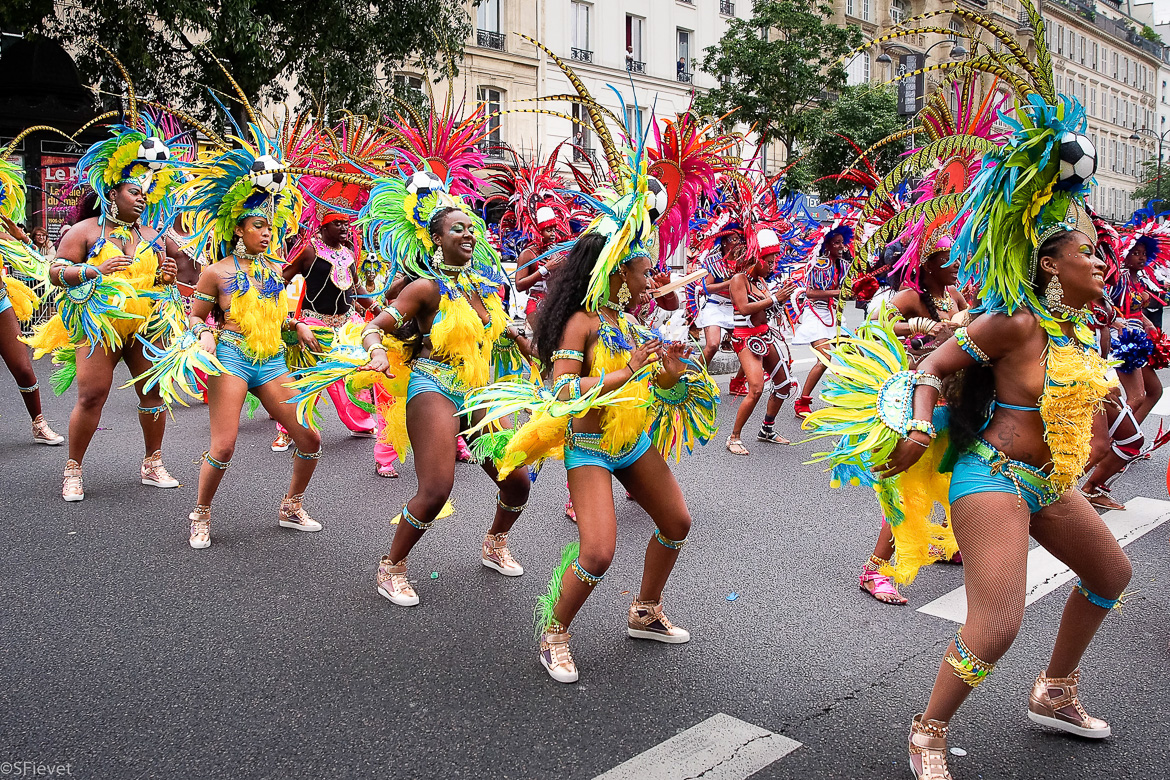 Image of dancers in colorful Caribbean costumes at Champs-Elysées