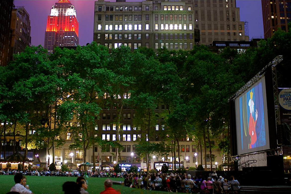 Image of people enjoying an outdoor movie in Bryant Park with the Empire State Building in the background