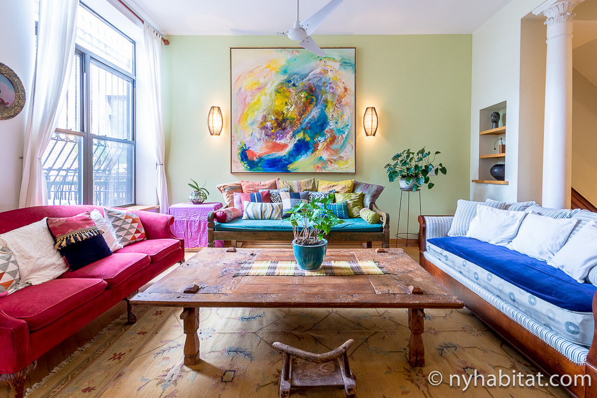 Image of 3 sofas in the living room of NY-11554 in Harlem
