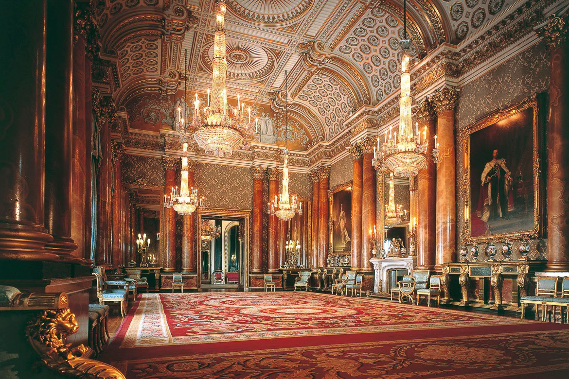 Image of a state room in Buckingham Palace with gilded ceiling and chandeliers
