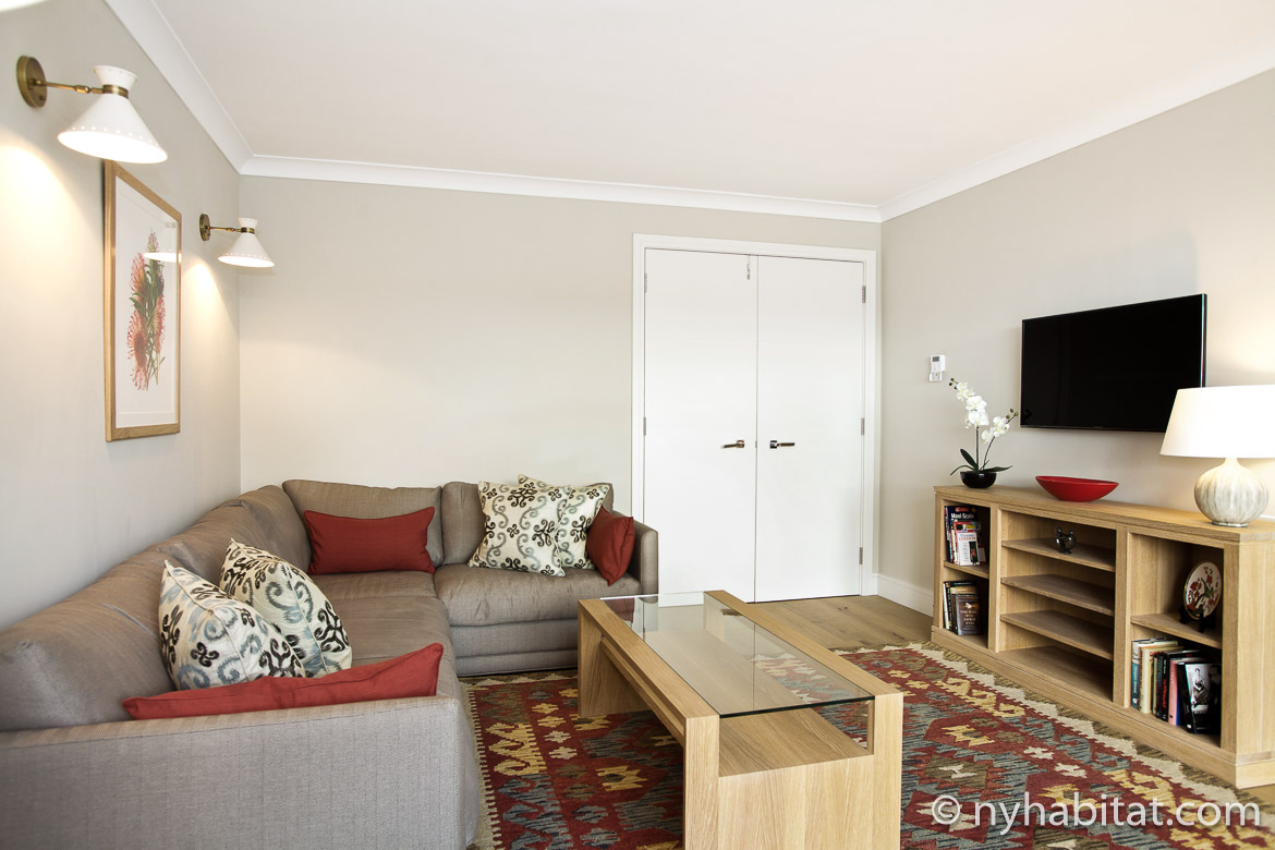 Image of living room in LN-1257 with sofa, television and glass coffee table