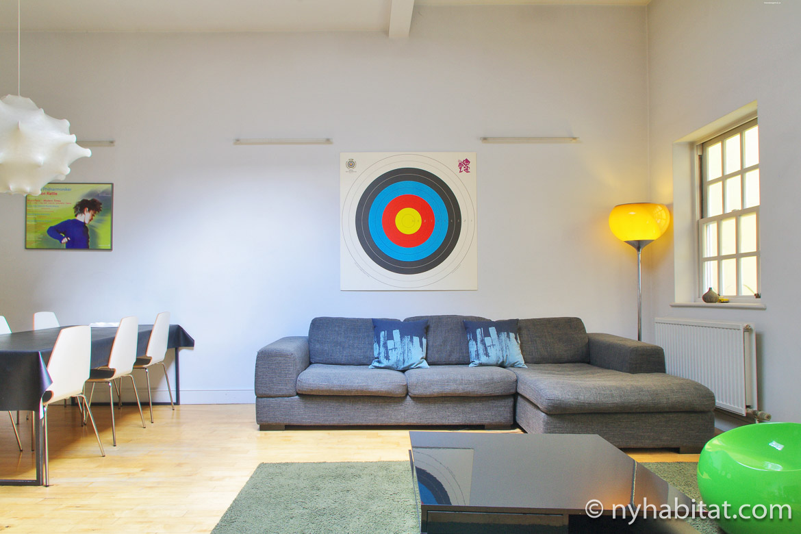 Image of living room in LN-1899 with gray sofa, yellow lamp and wall art