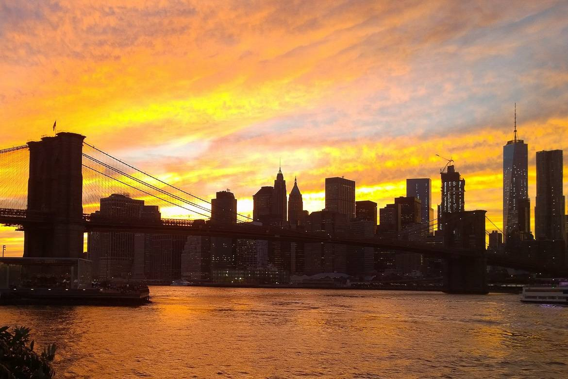 Image of Manhattan skyline at sunset as seen from Brooklyn.