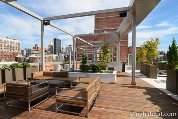 Image of rooftop of NY-17115 with sectional seating and metal cabana structures.