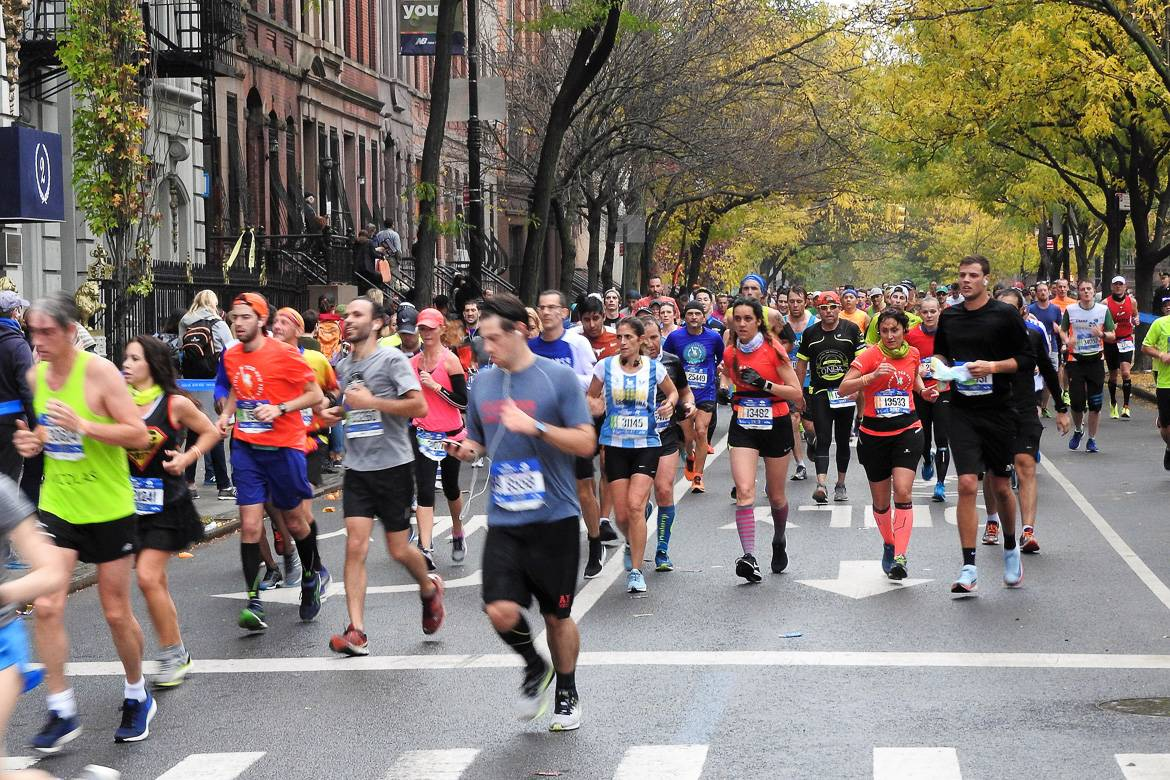 Image of runners in the New York City Marathon running through the Upper West Side.