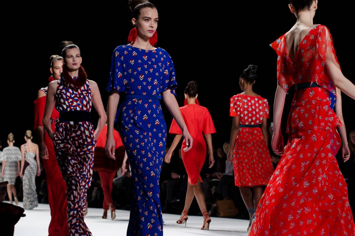 Image of models during the finale of a runway show at Paris Fashion Week.