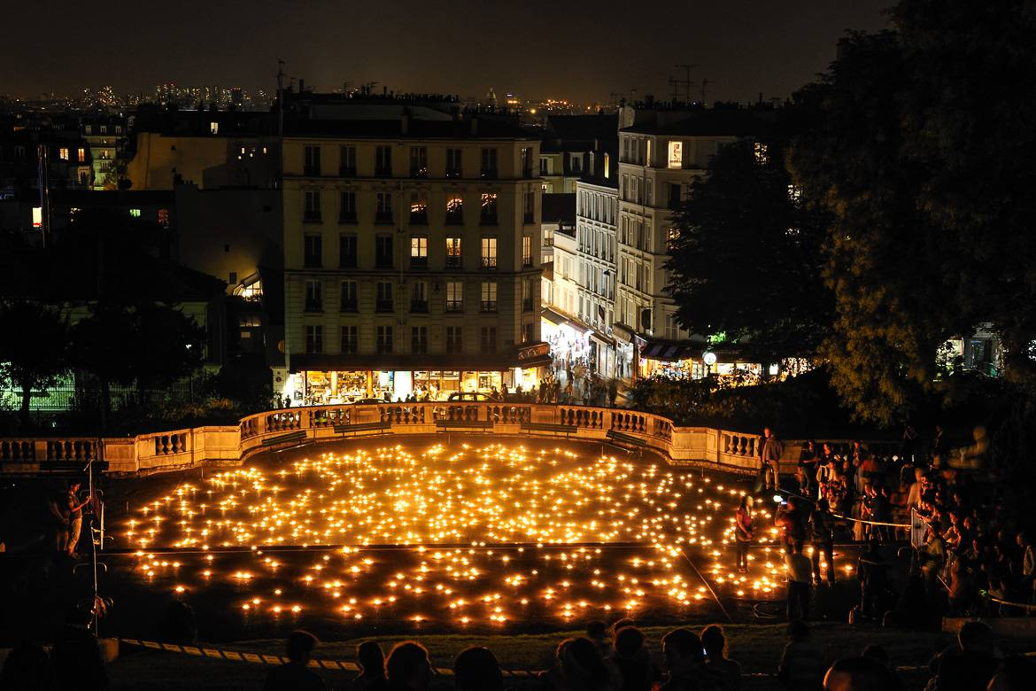 Image of Montmartre plaza lit up with candles during the celebration of Nuit Blanche.
