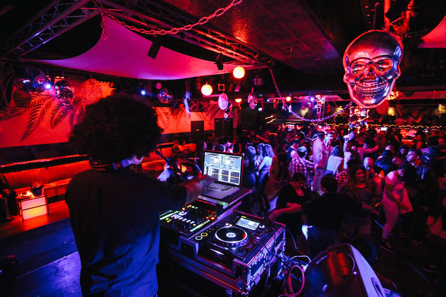 Image of DJ, Halloween decorations and people dancing at Copacabana Nightclub in NYC.
