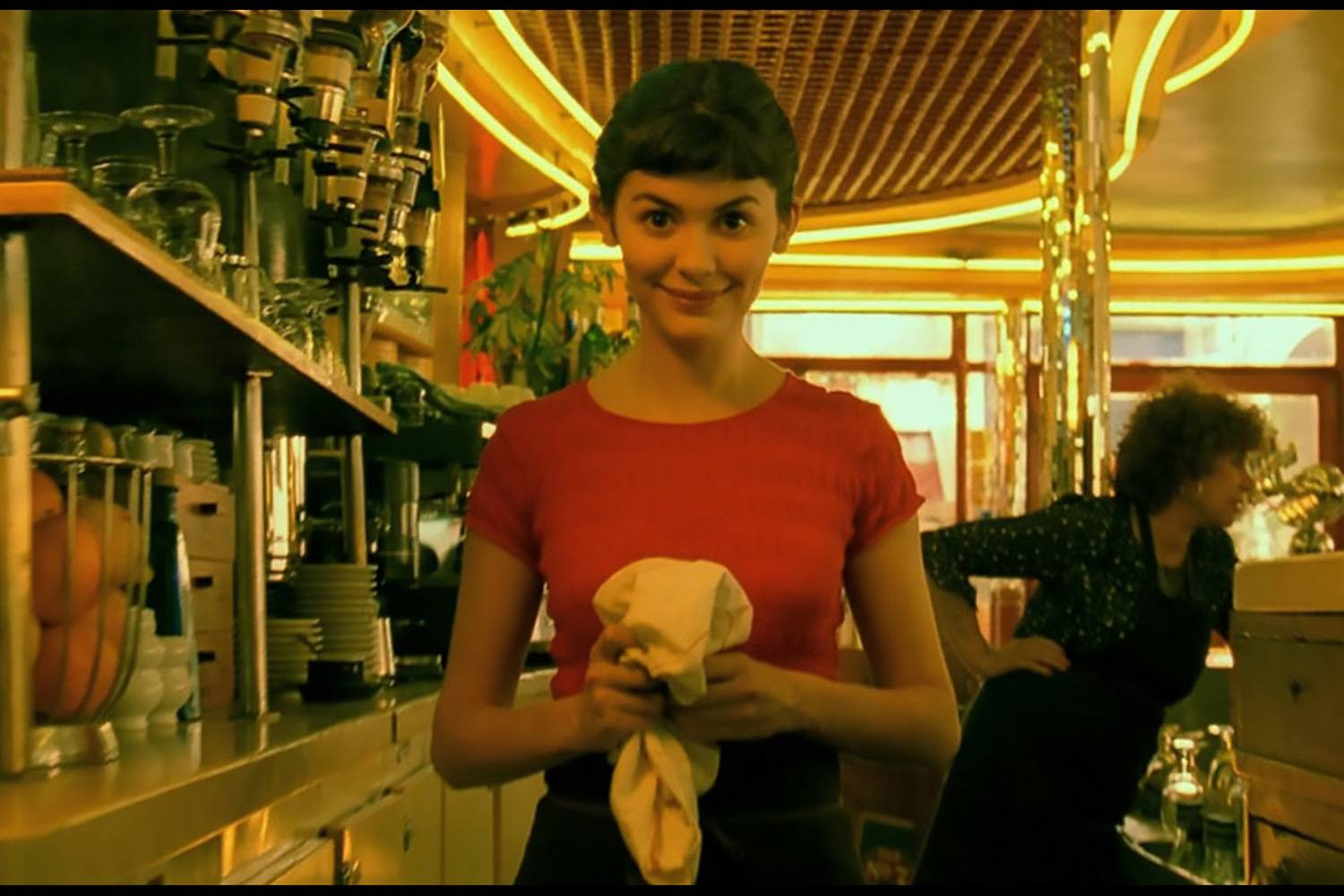 Image still of actress Audrey Tatou in Café des deux Moulins in the film Amelié.