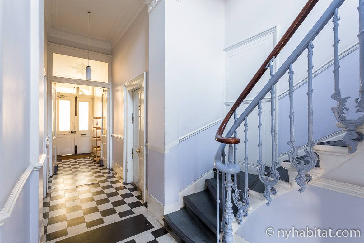 Image of apartment hallway and staircase in a shared London building.