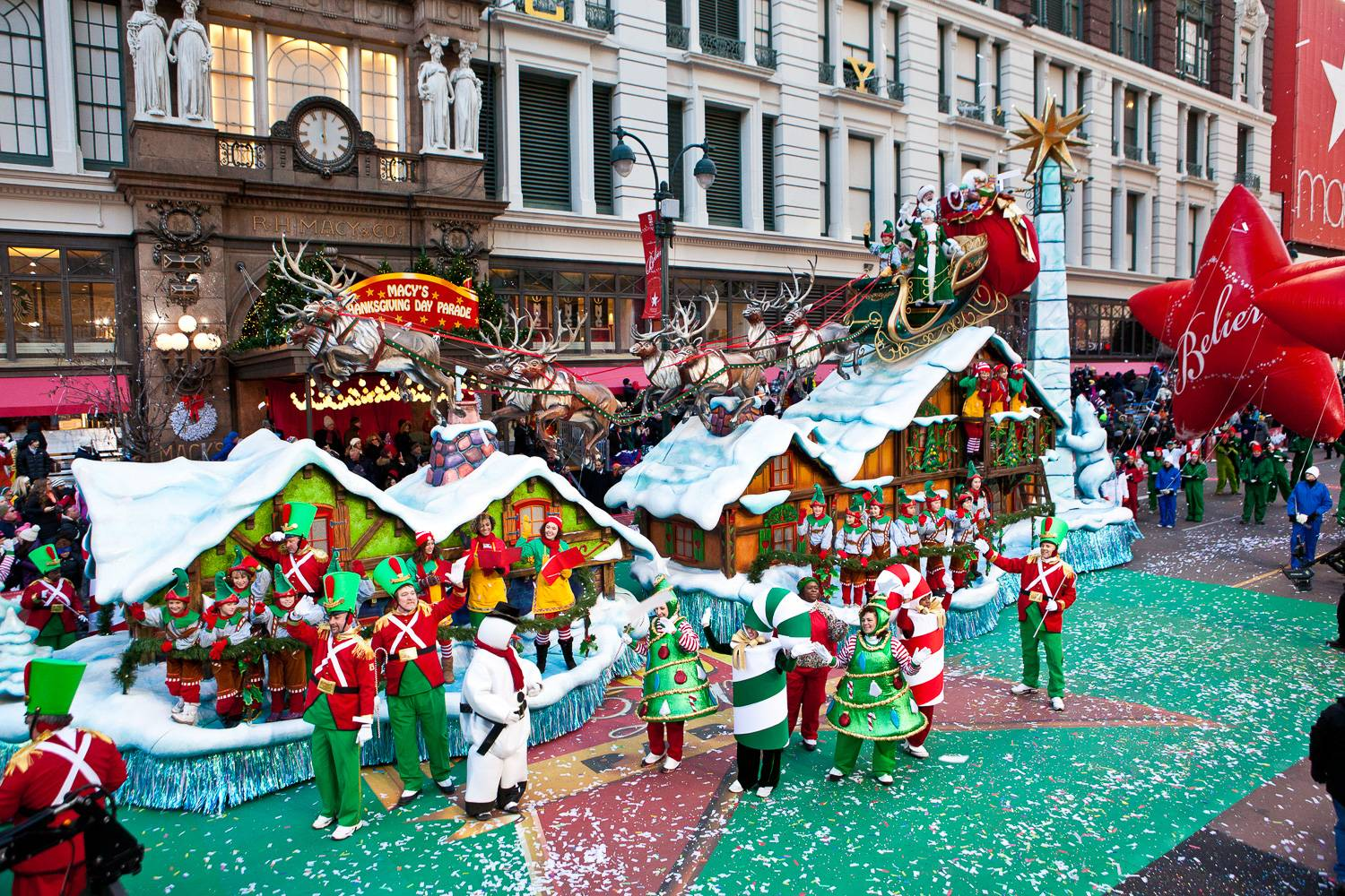 Image of Santa Claus on a Christmas-themed float in the Macy's Thanksgiving Day Parade in Herald Square