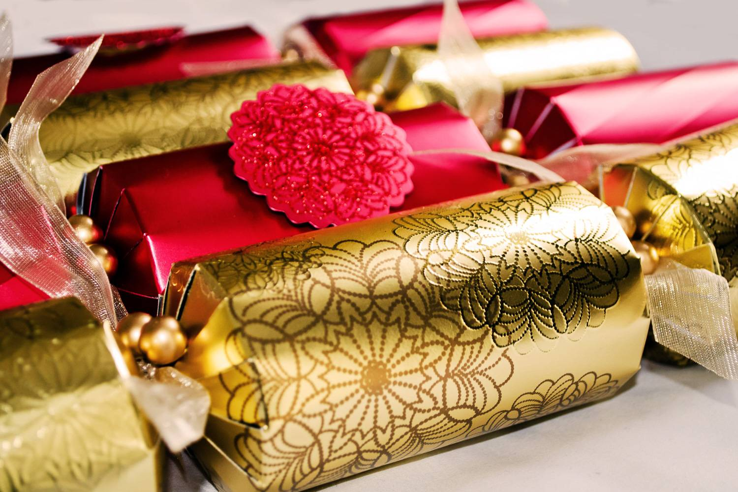 Image of red and gold English Christmas crackers.