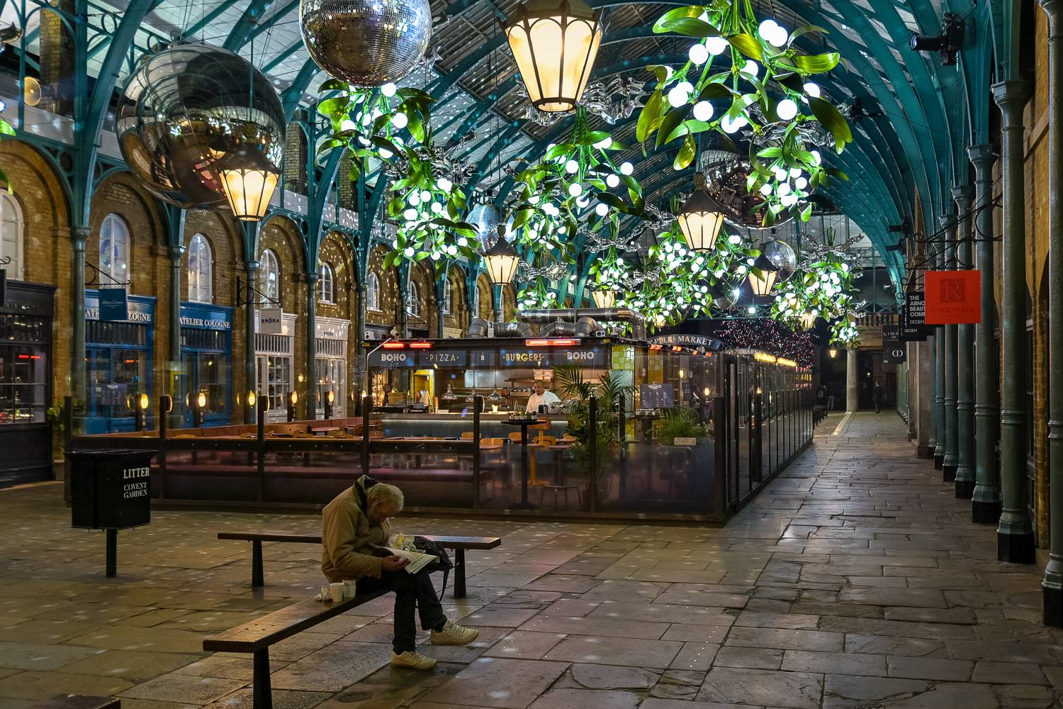 Image of Covent Garden Market decorated for the holidays with light-up bunches of mistletoe.
