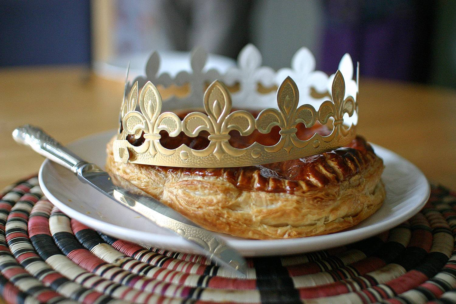 Image of galette des rois cake with paper crown.