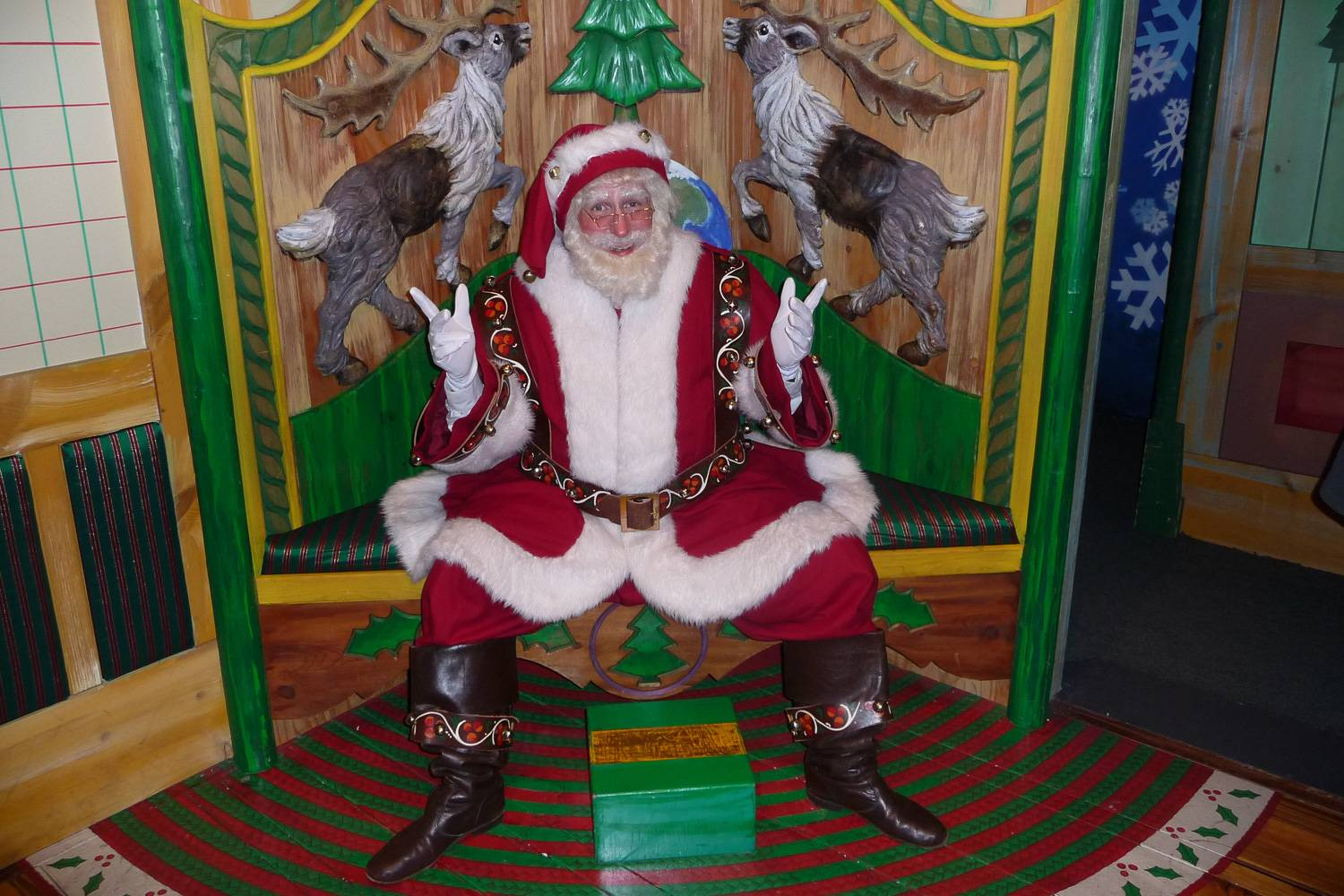 Image of Santa Claus waiting to greet visitors to Macy's flagship store in Herald Square, New York City.
