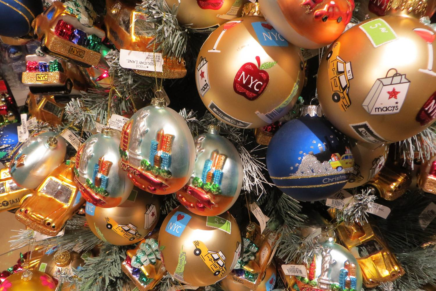 Image close-up of a Christmas tree with New York City-themed holiday ornaments.