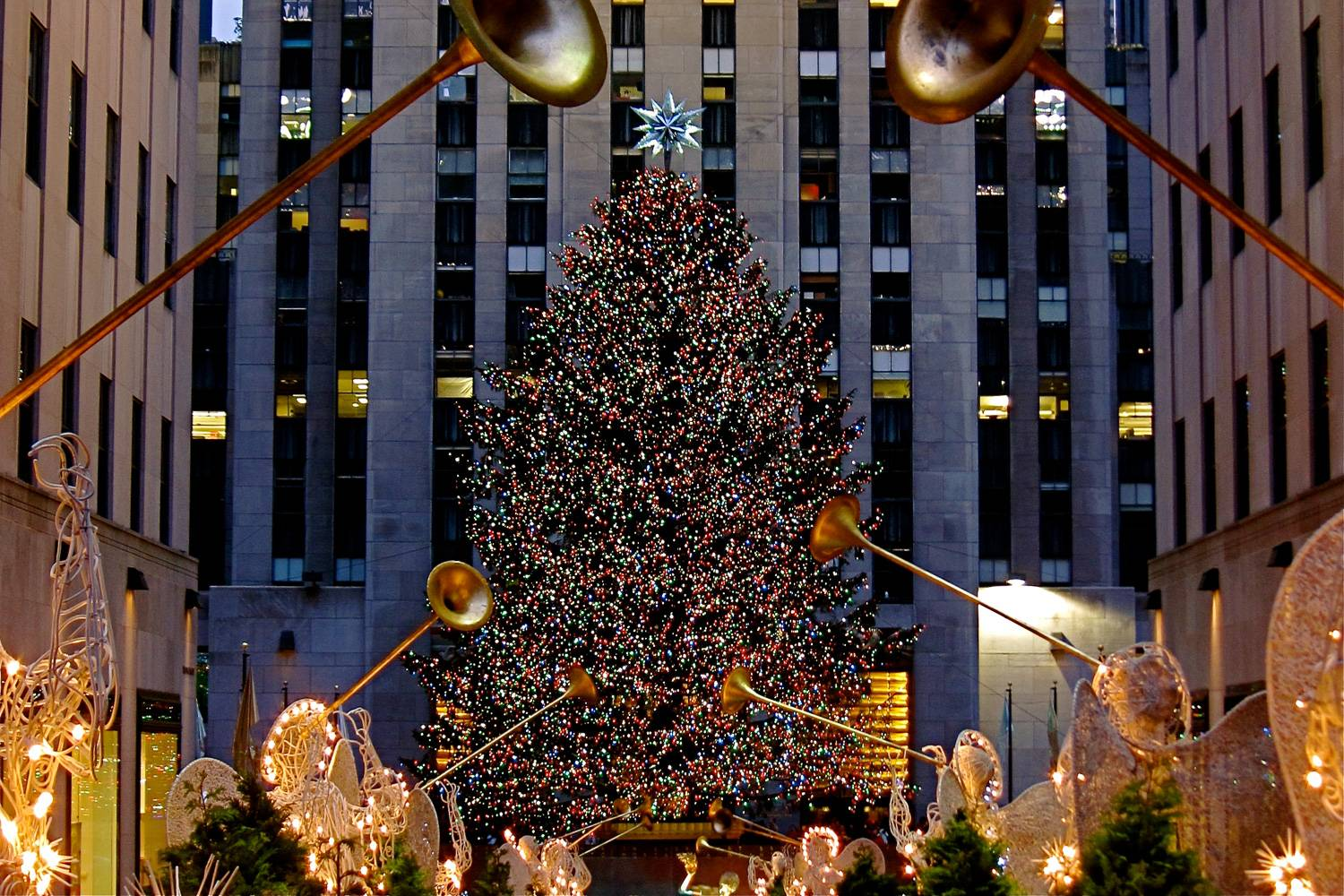 Image of the Christmas tree in Rockefeller Center decorated for the holidays.