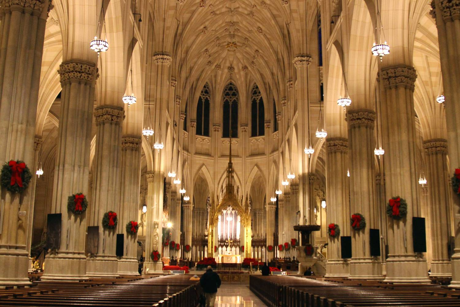 Image of St. Patrick's Cathedral in New York City, decorated with wreathes for Christmas.