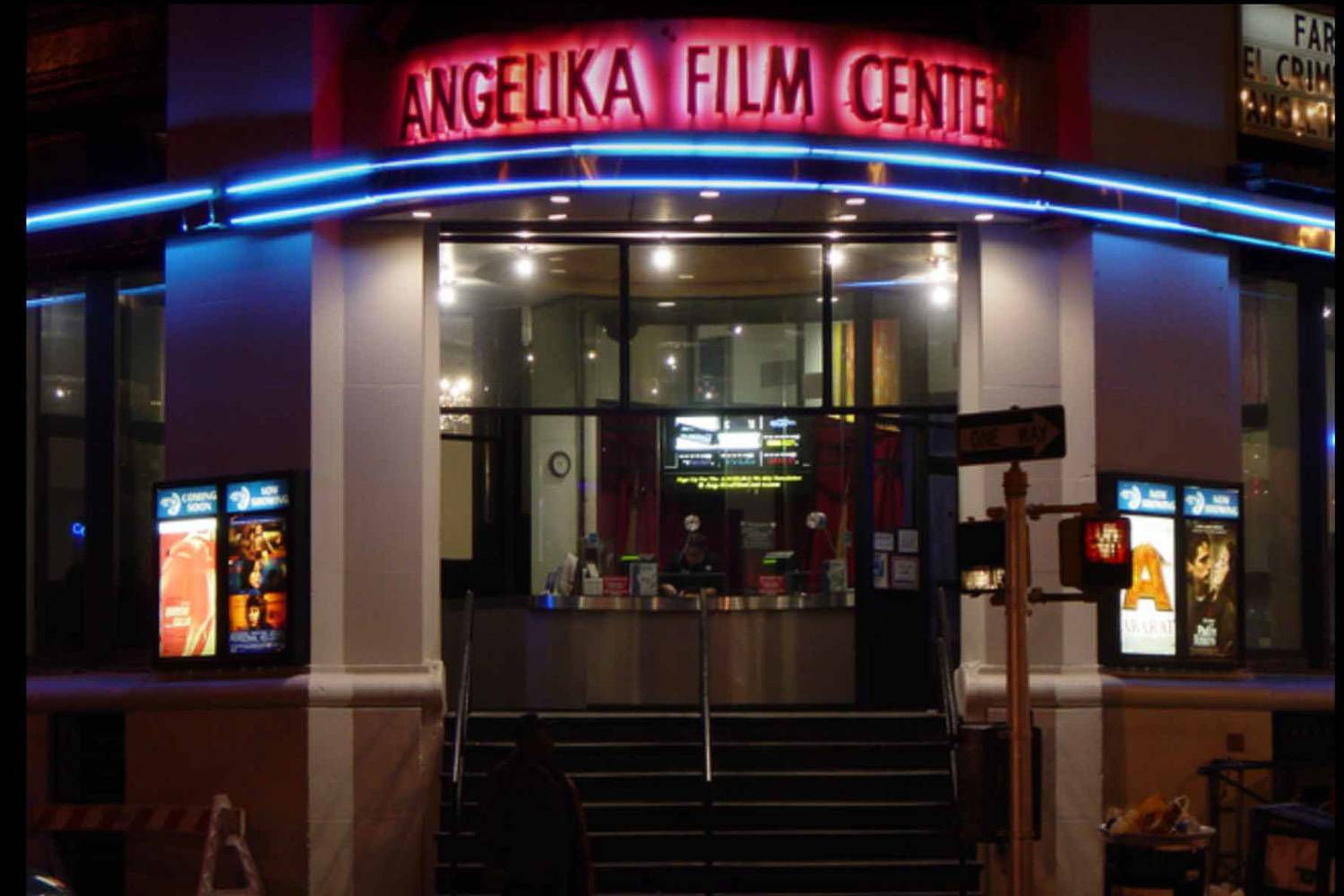 Image of entrance of Angelika Film Center with neon-lit sign.