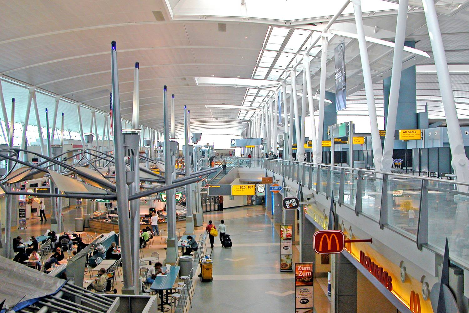 Image of interior of one of the terminals of JFK Airport with fast food restaurants.