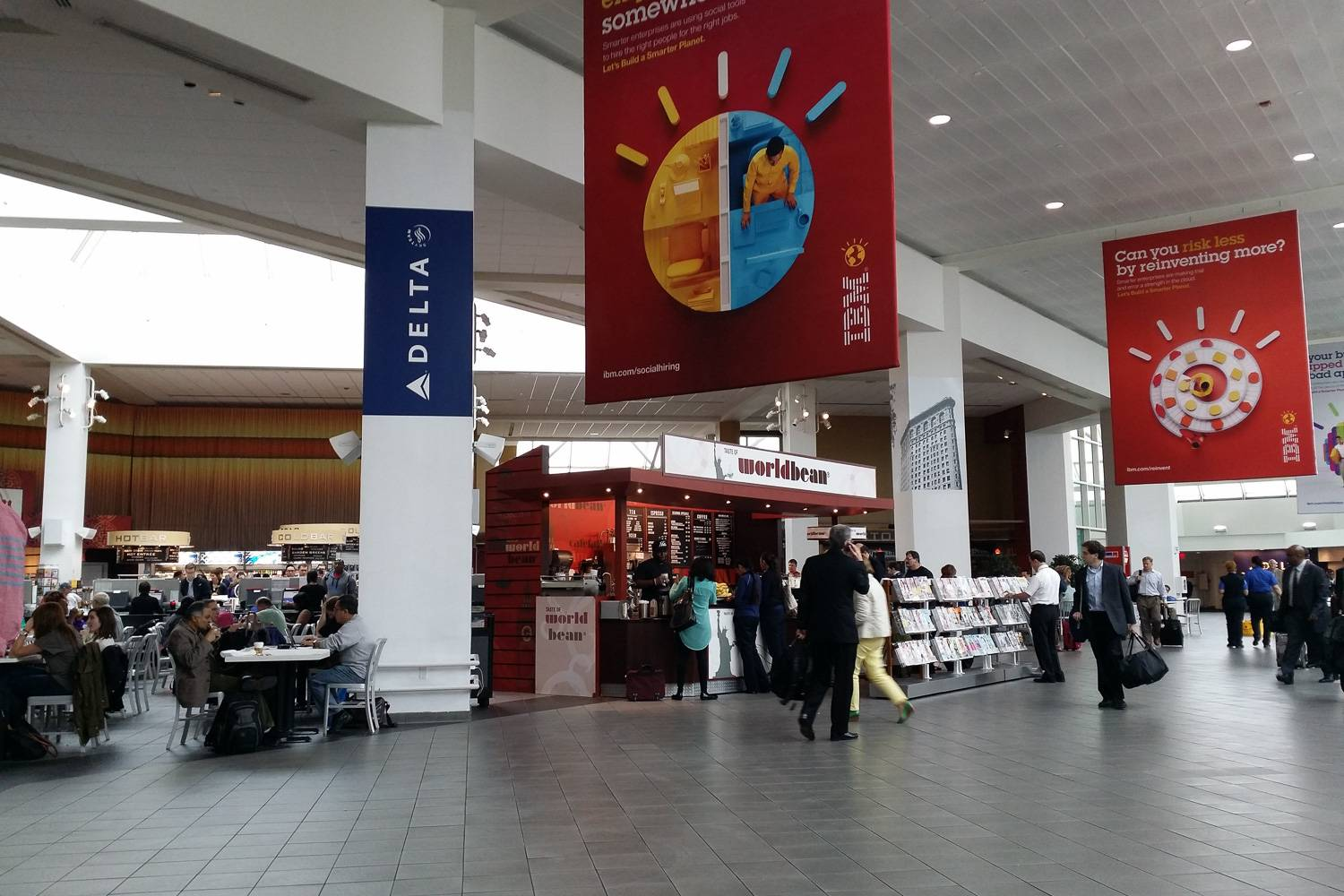 Image of interior of a terminal in LaGuardia Airport with food vendors.