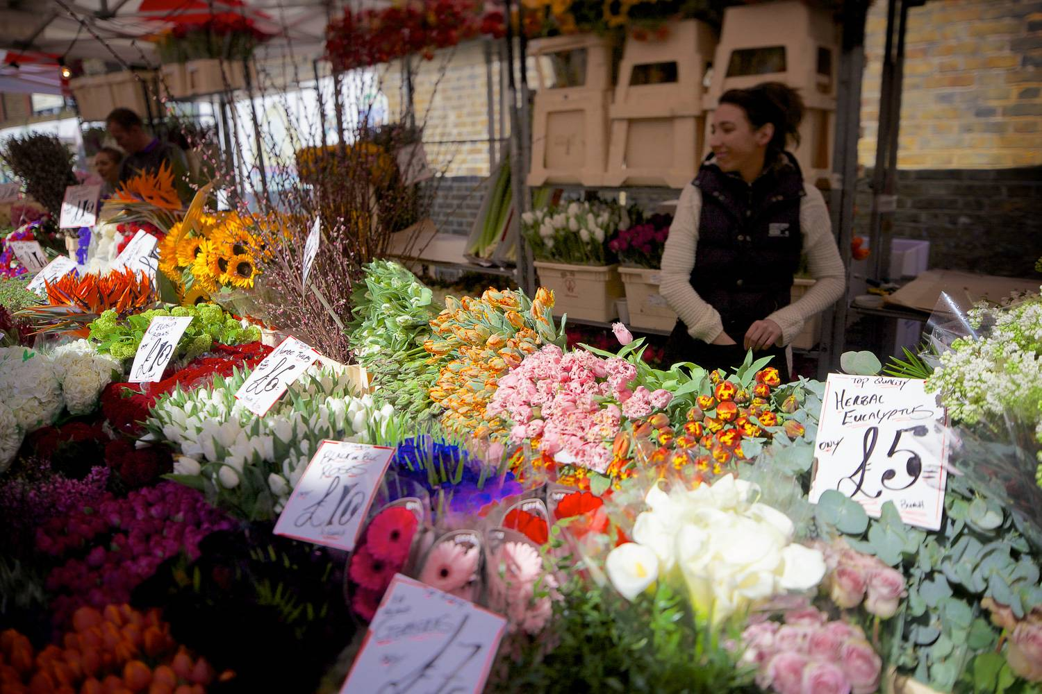 Image of a stall selling flowers at the Columbia Road Flower Market in London.