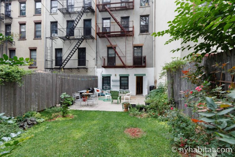 Image of backyard garden area in NY-16507 furnished apartment.