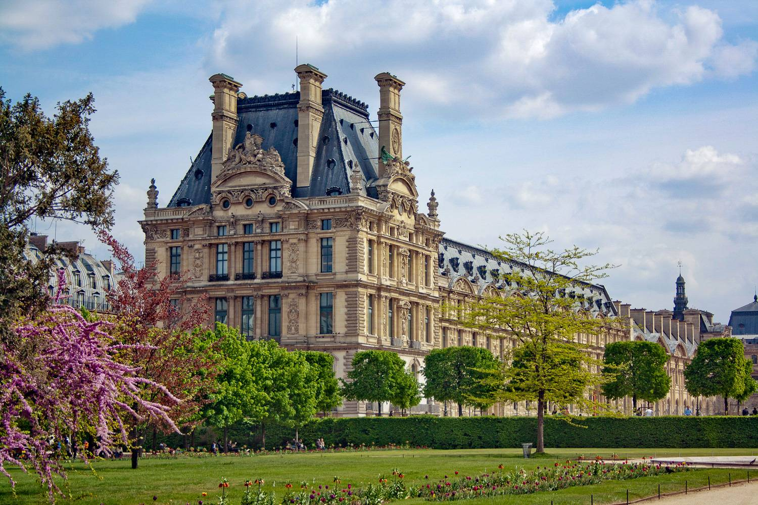 Image of the Louvre Museum in Paris from Tuileries Garden in spring.