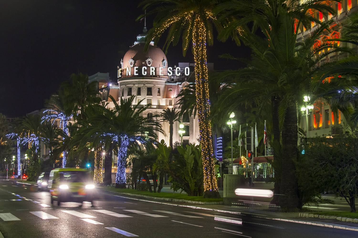 Image of Le Negresco hotel on the Promenade Anglais in Nice at night.