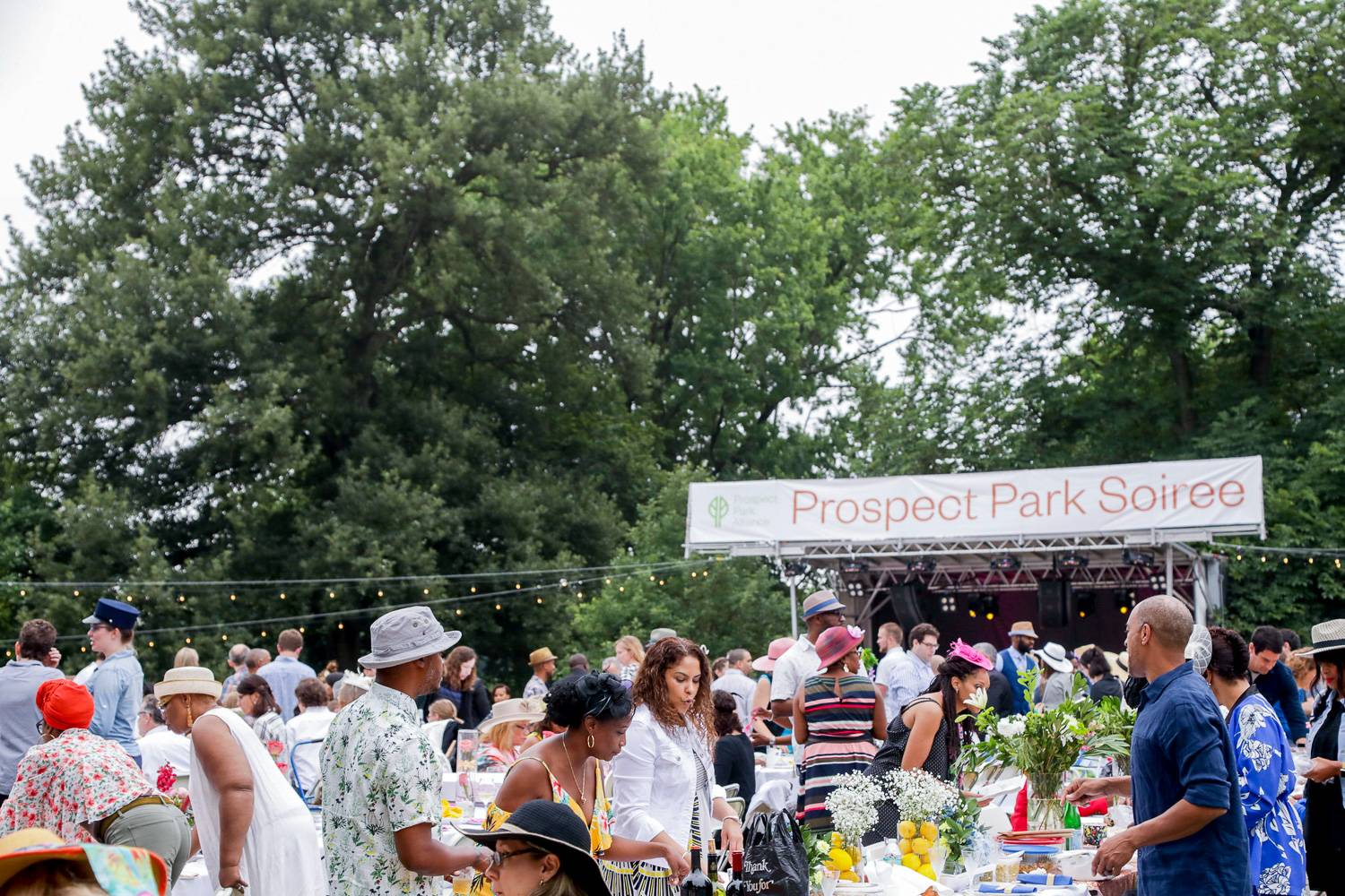 Image of guests at the Prospect Park Soiree in the summer.