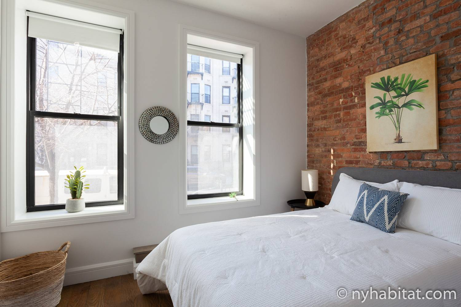 Image of bedroom in NY-17871 with full-sized bed and artwork.