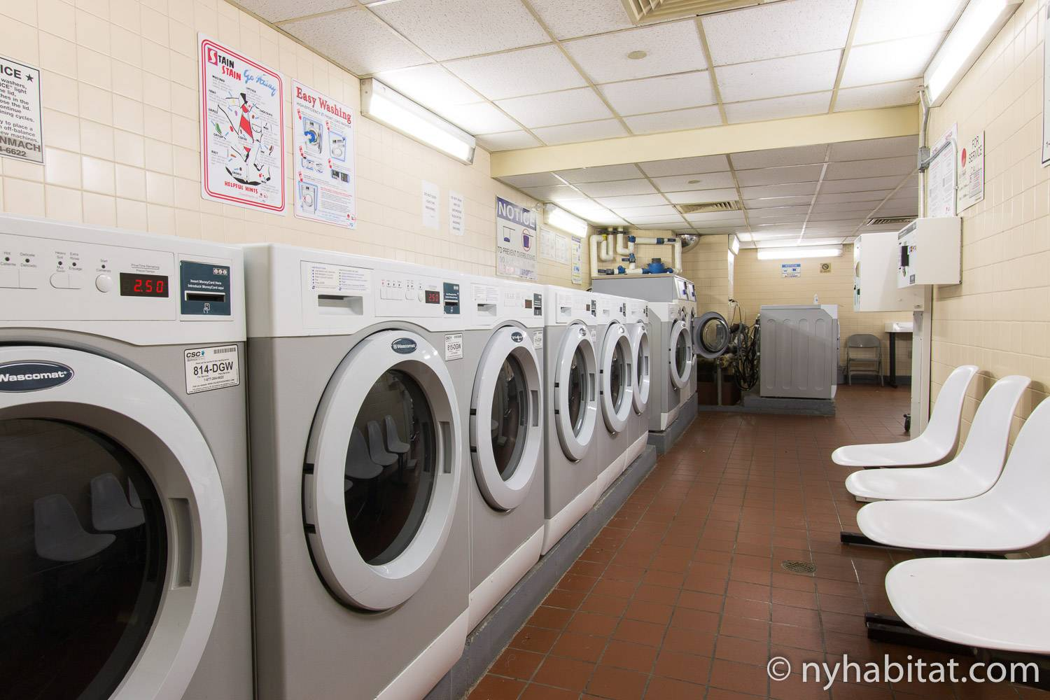 Image of laundry room in the building of Midtown West apartment rental NY-12939.