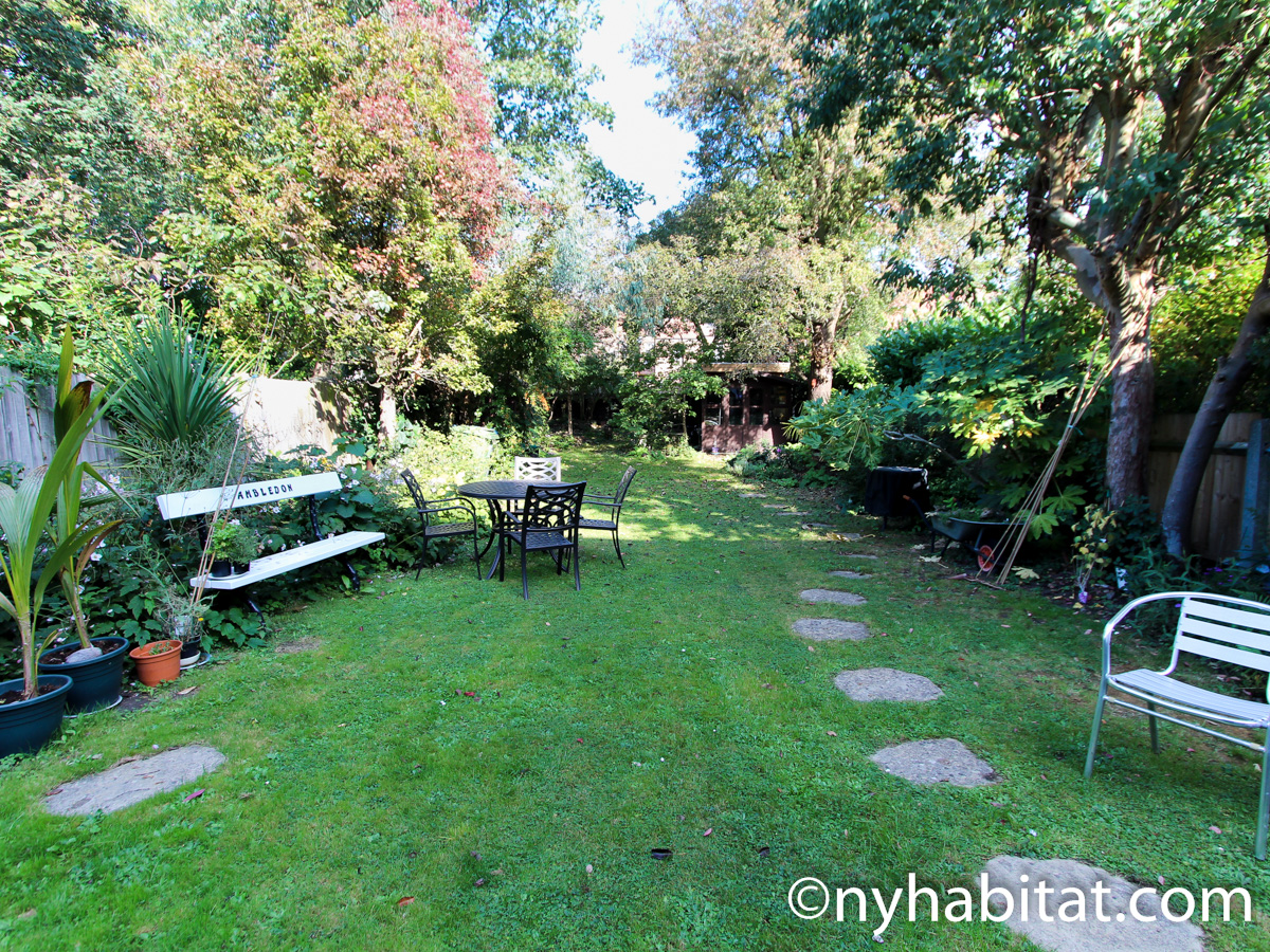 Image of fenced backyard garden in LN-24 with bench.