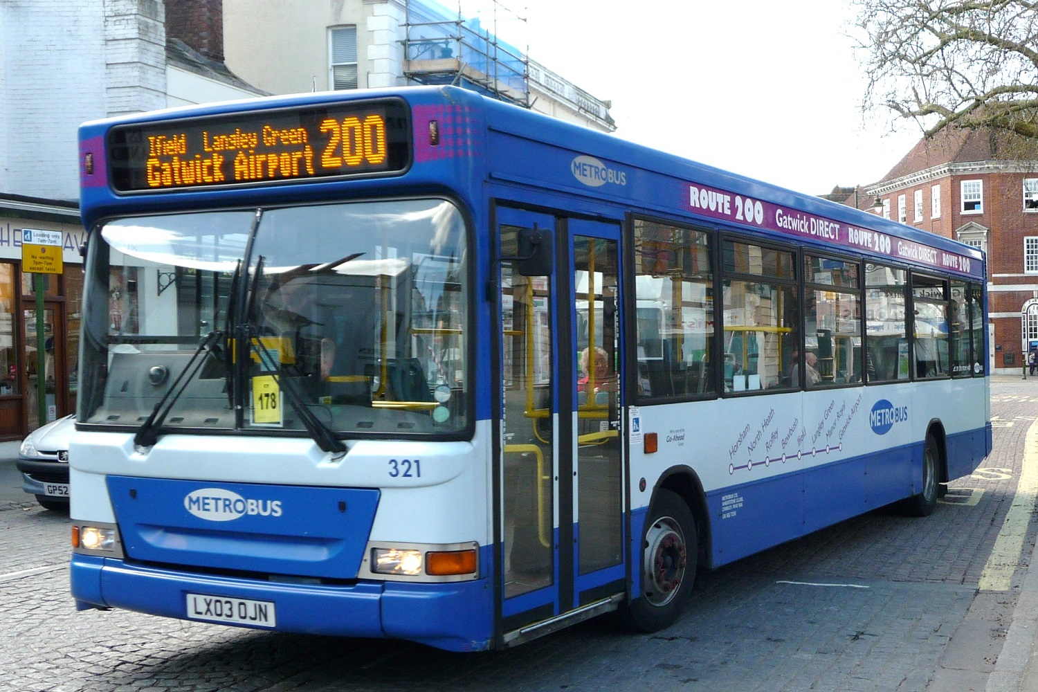 Image of a blue London bus bound for Gatwick Airport.