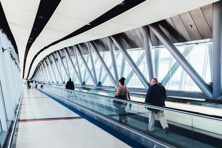 Image of passengers crossing through a terminal bridge at Gatwick Airport.