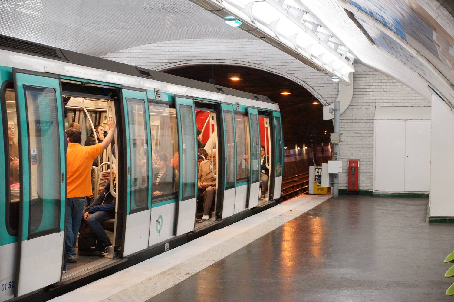 Image of a Métro train sitting in Anvers Station in Paris.