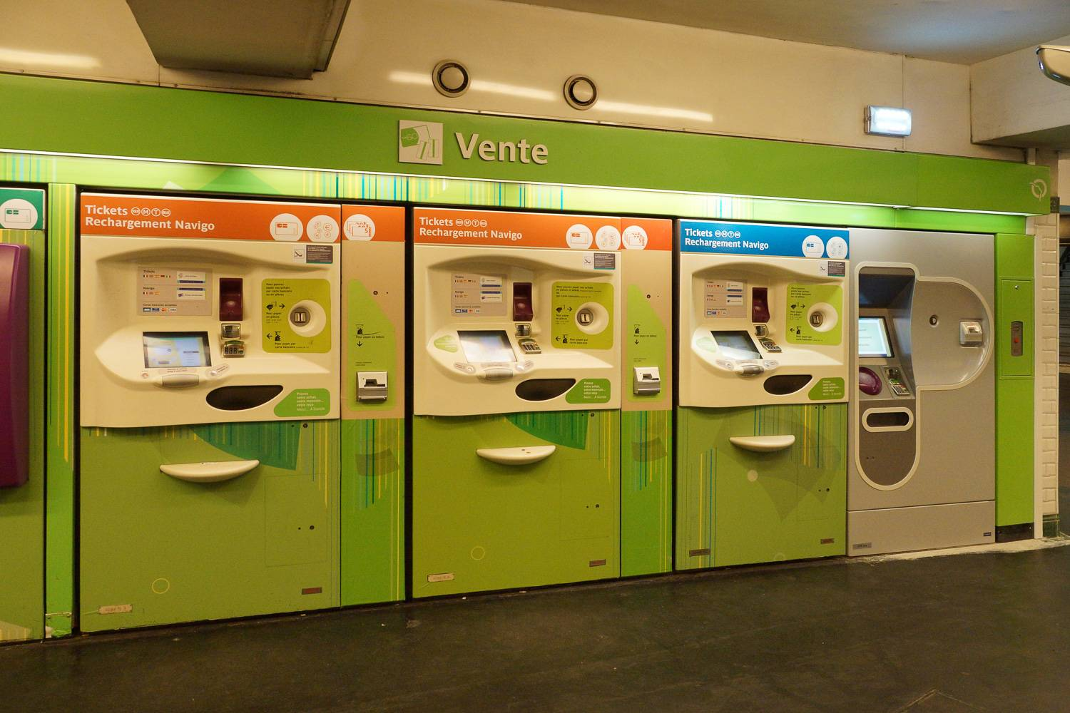Image of green Navigo ticket machines in Alesia metro station in Paris.