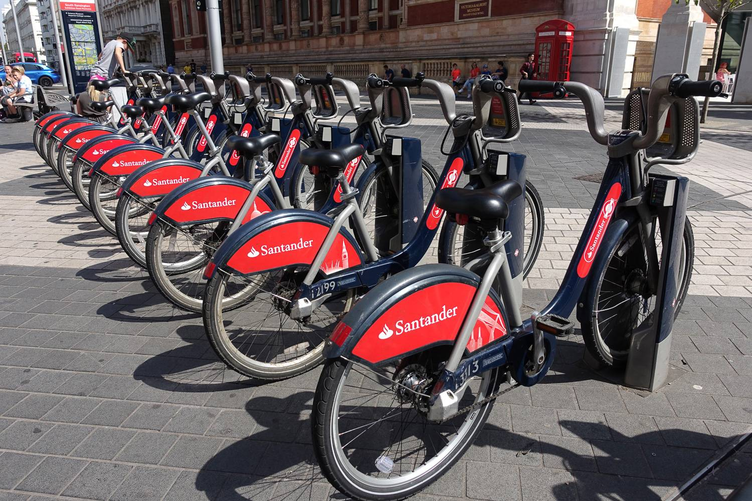 Image of red Santander Cycles lined up at a docking station in London.