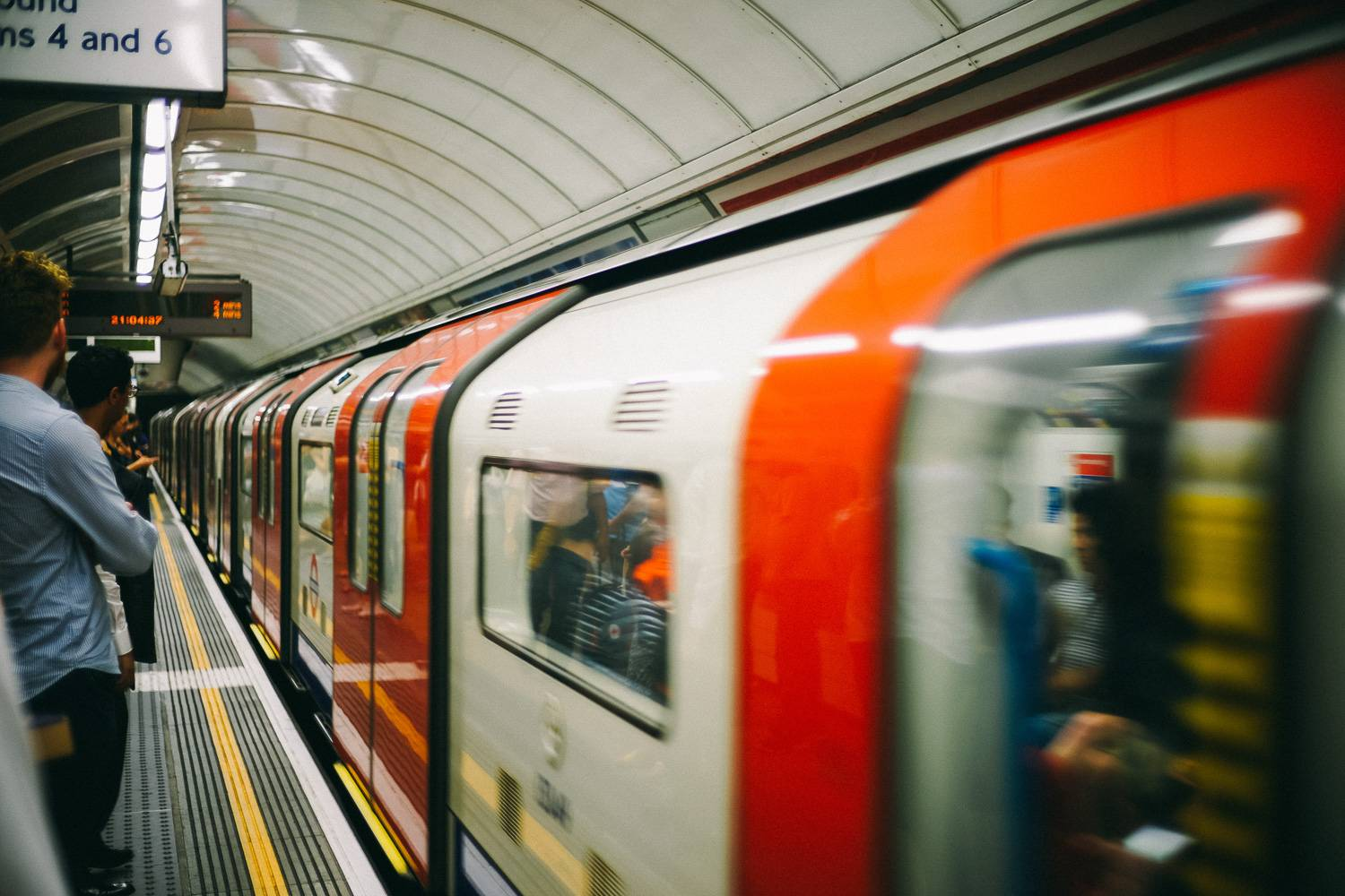 Image of a London Underground train pulling into a Tube station.