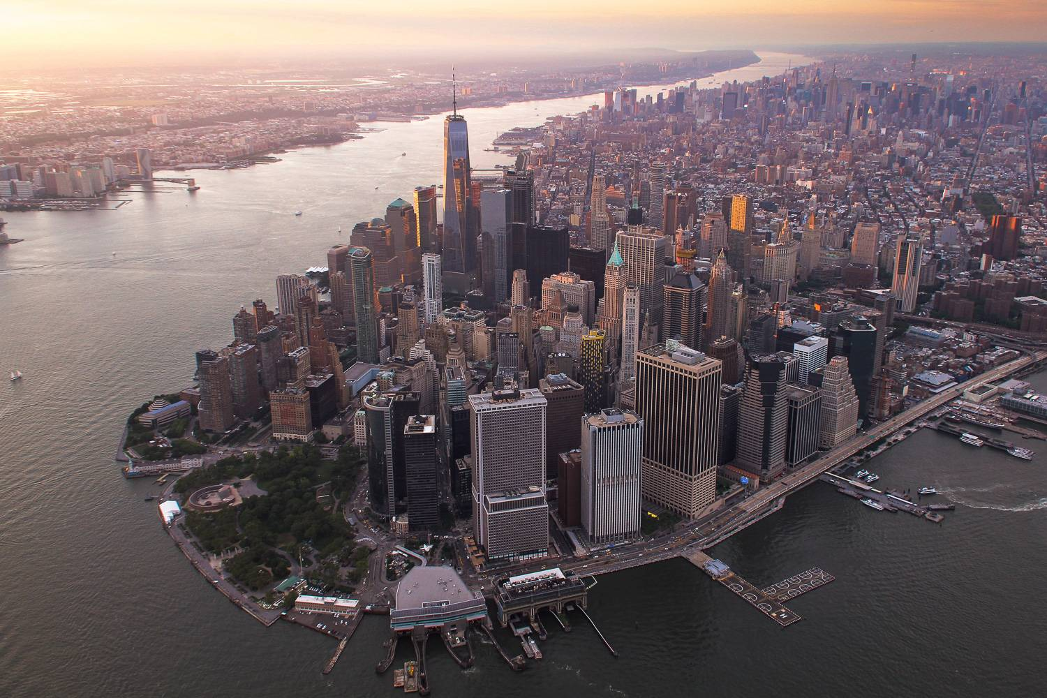 Image of the Financial District and Lower Manhattan from above at dusk.
