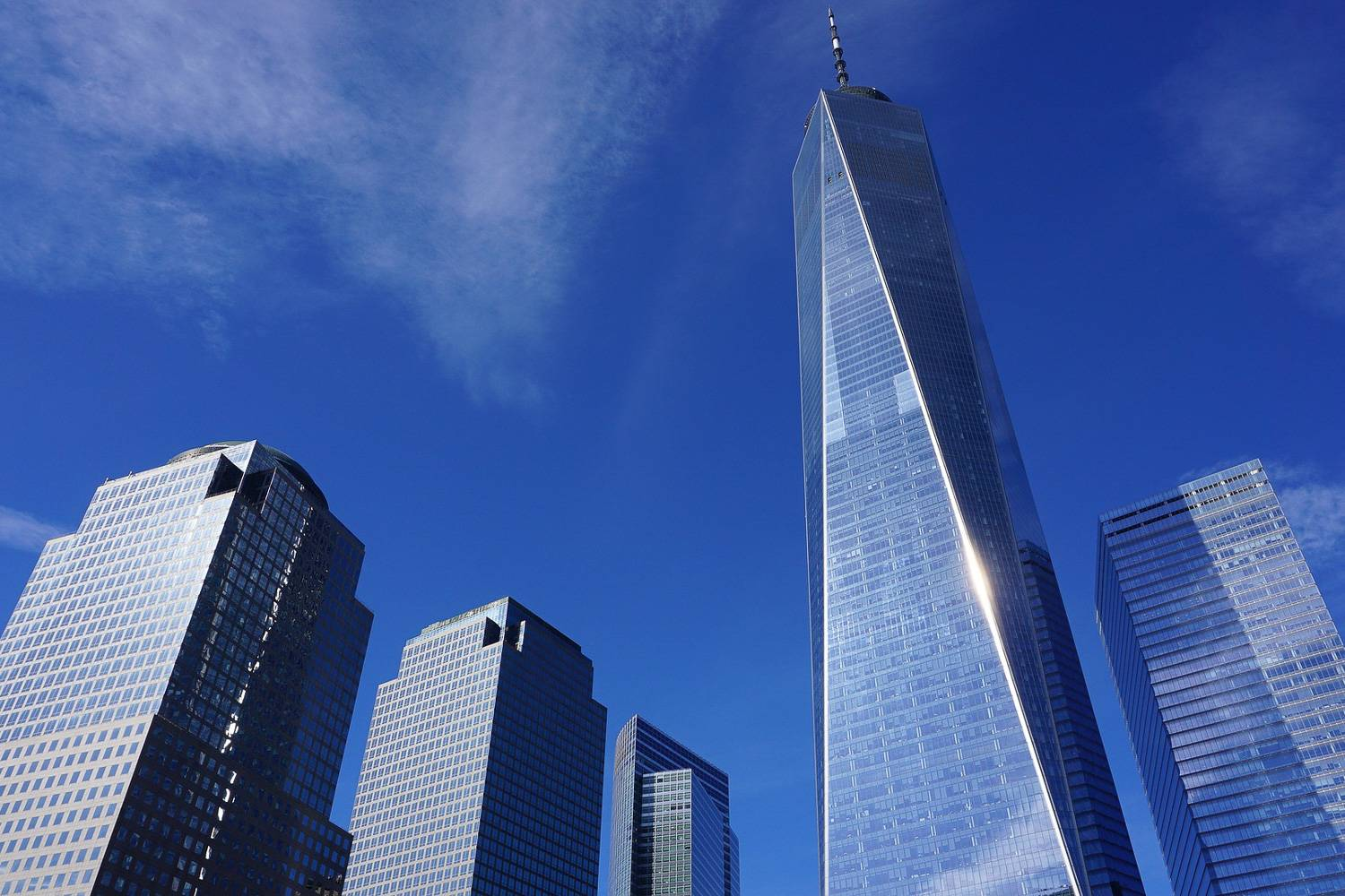Image of the One World Trade Center building as seen from the ground.
