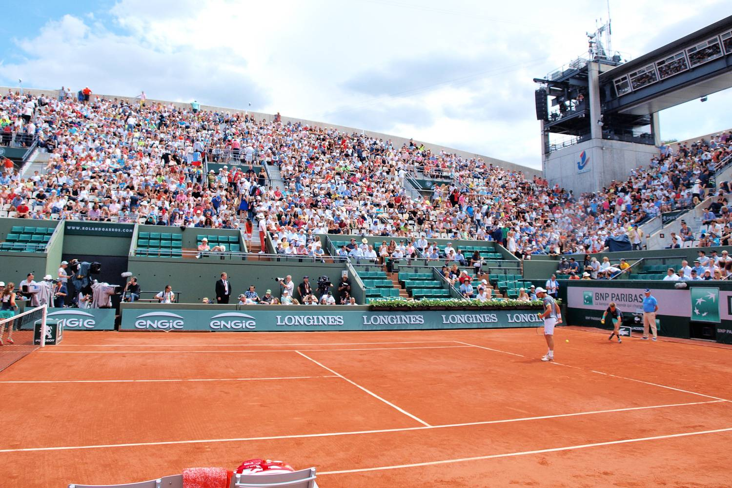 Image of players on the clay court at Roland-Garros in Paris.